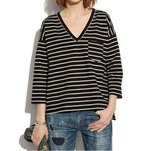Black/White striped ponte knit v neck top.